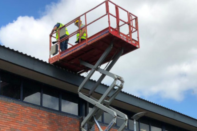 Roofer Using Scissor Lift