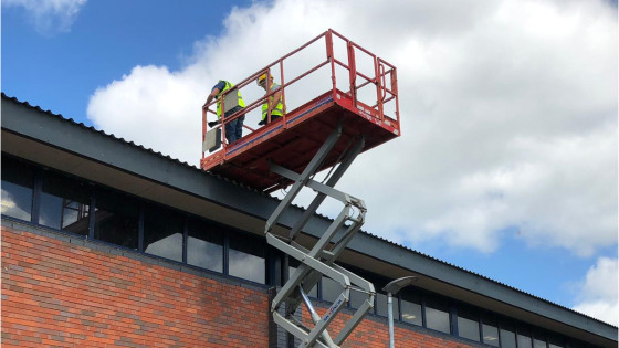 Scissor Lift on roofing project
